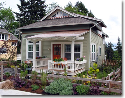 I love this little house with the big front porch (or at least porportionally so).