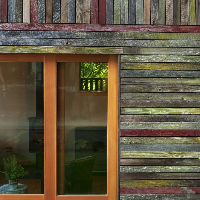 Reclaimed paneling from old barn finds.