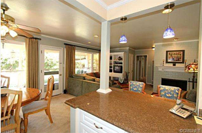 I like the open kitchen/dining area/living room remodel. The interior has definitely been remodeled and kept nicely.
